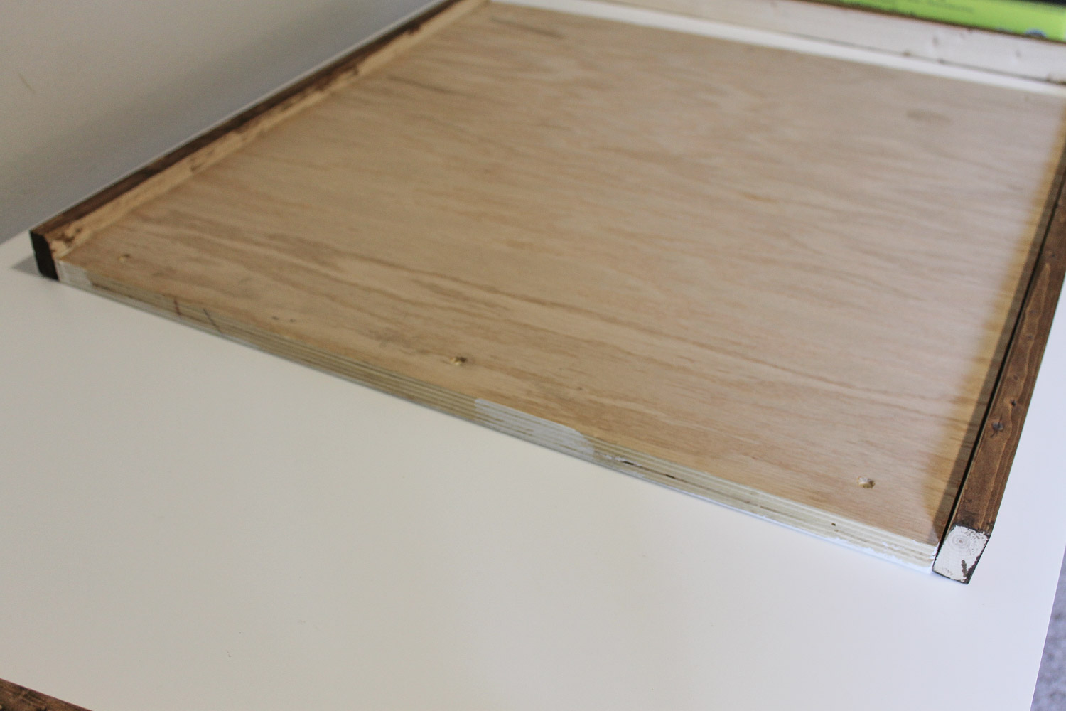 Attaching wood sign frame pieces to sign backing