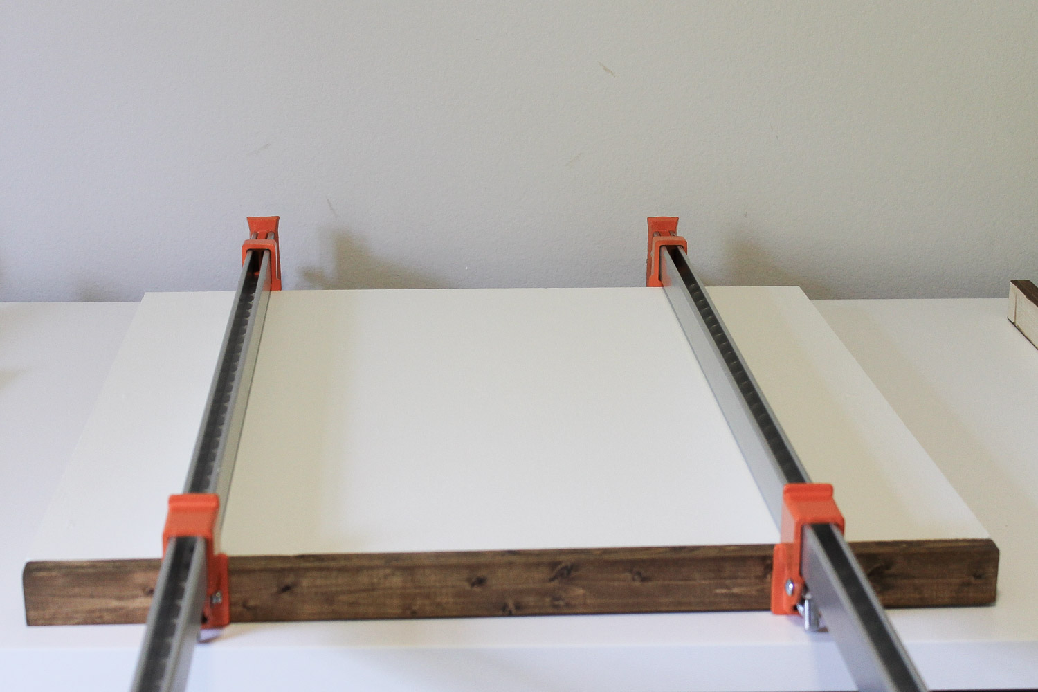 Attaching DIY wooden sign frame pieces to painted sign backing