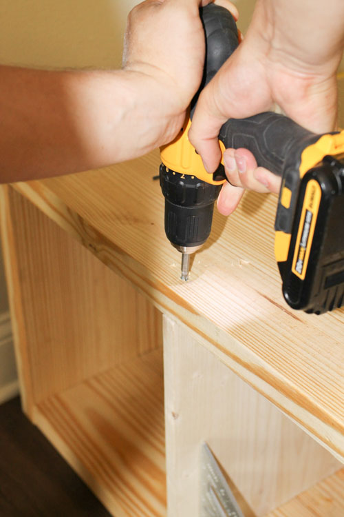Attach bench cubby divider with drill and wood screws