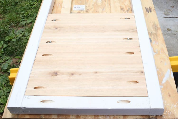 attaching planter stand cedar wood boards to planter stand frame with Kreg screws