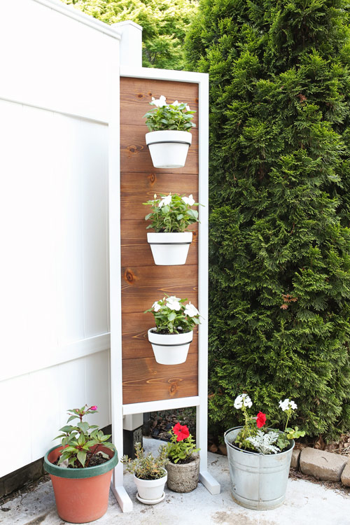 DIY Plant stand with flowers on back patio