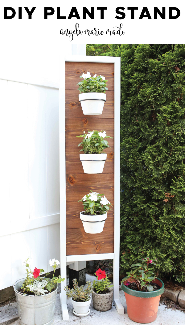 diy wood plant stand with white flowers