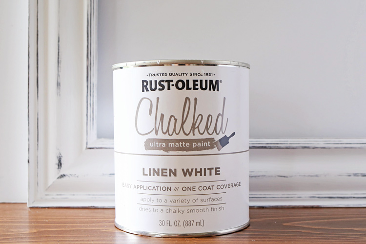 Can of rustoleum chalk paint linen white and picture frame