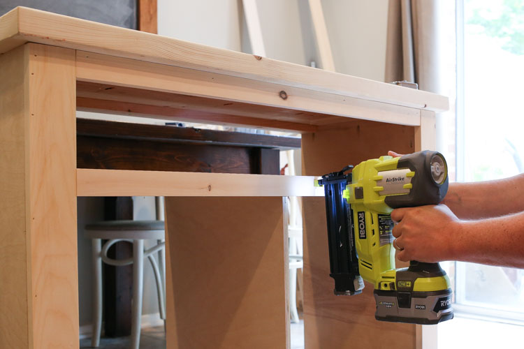 Attaching trim to DIY TV stand with brad nailer