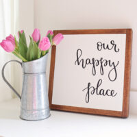 Our Happy Place DIY Wood Sign with pink tulips in galvanized pitcher