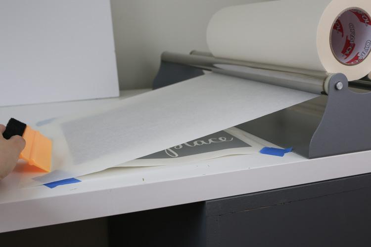 Apply transfer tape to vinyl stencil