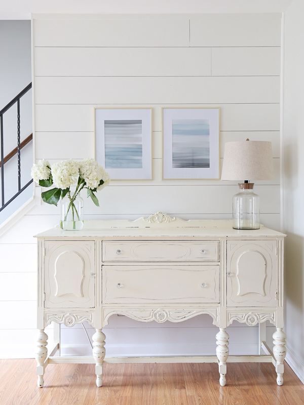 White vintage buffet and two abstract painting prints