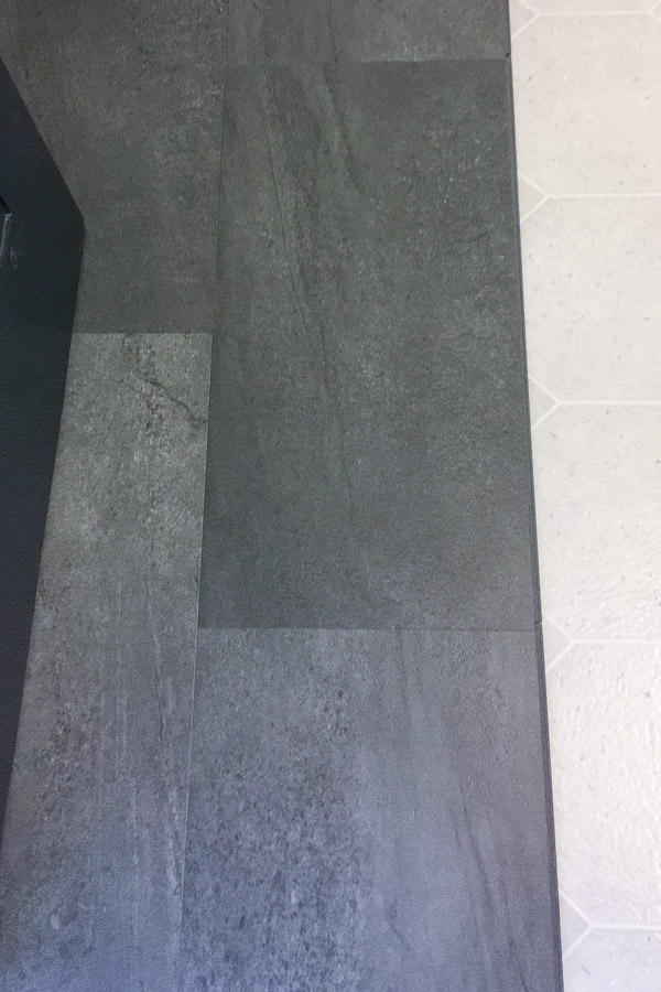 half covered bathroom floor with new luxury vinyl tile