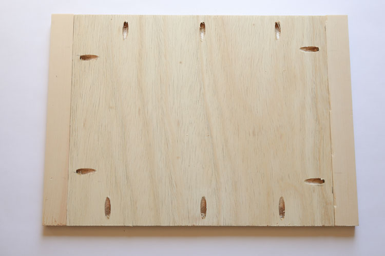 Three pocket holes on each side of the two plywood pieces for DIY vanity sides