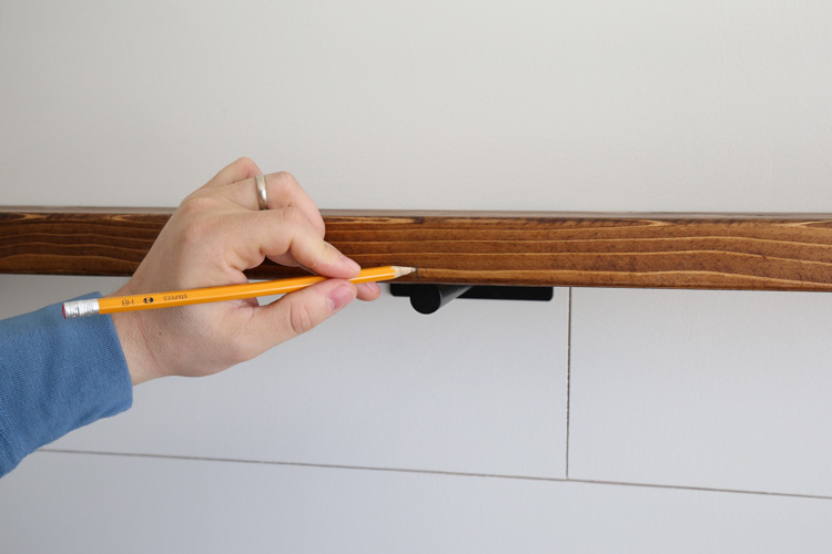 Marking floating shelf where bracket centerpoint is located