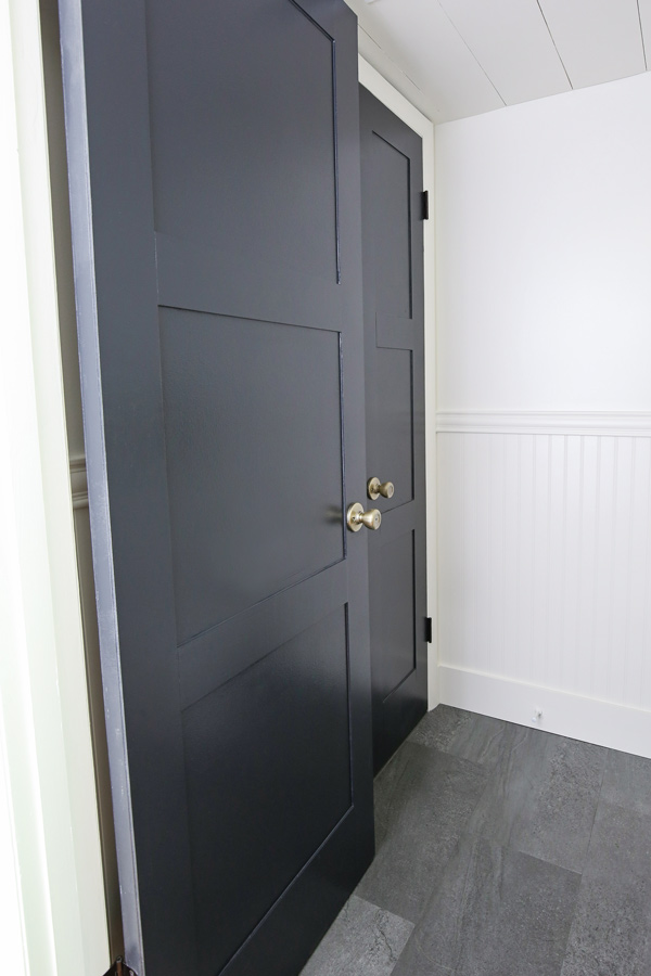 Updated black panel doors in a bathroom makeover