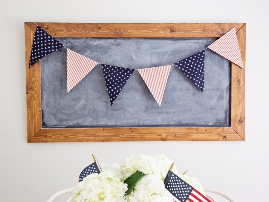 American Flag banner on chalkboard