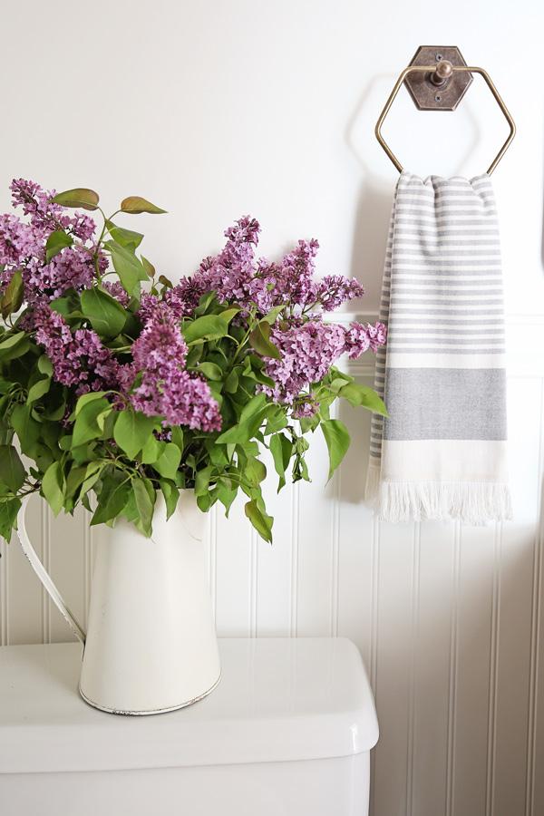 lilacs in bathroom