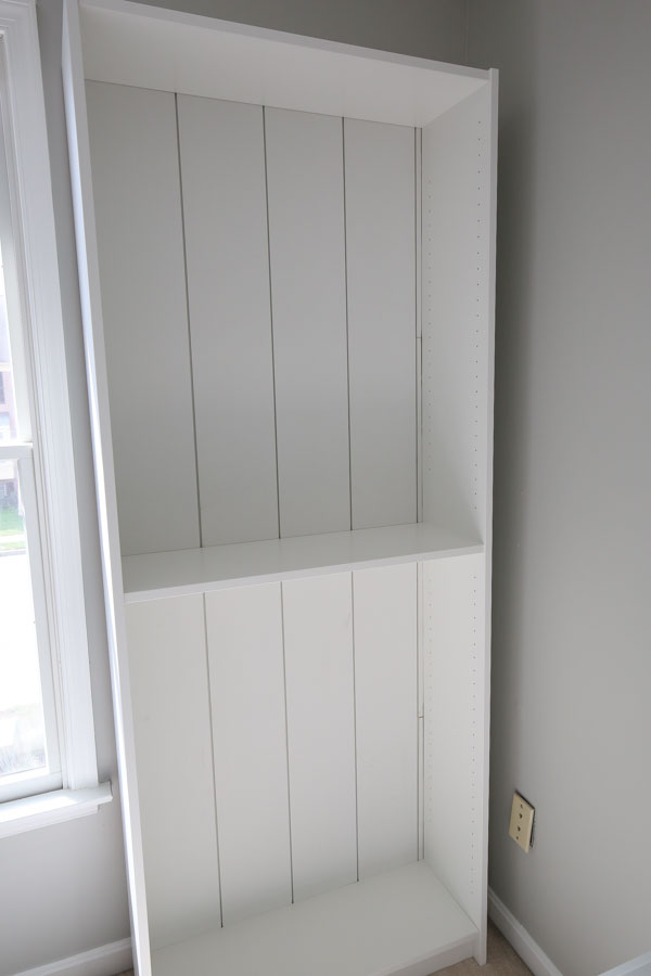 Front view of shiplap boards added to IKEA bookcase