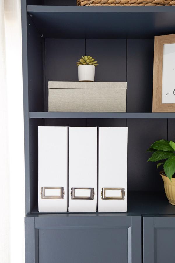 DIY magazine holders on bookshelf