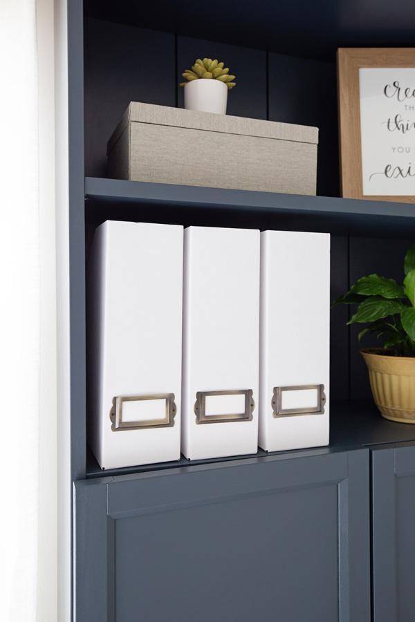 DIY magazine holders on bookshelf in office