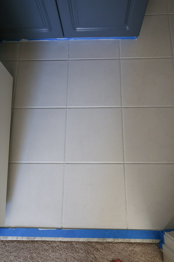 Bathroom tile floor covered with primer