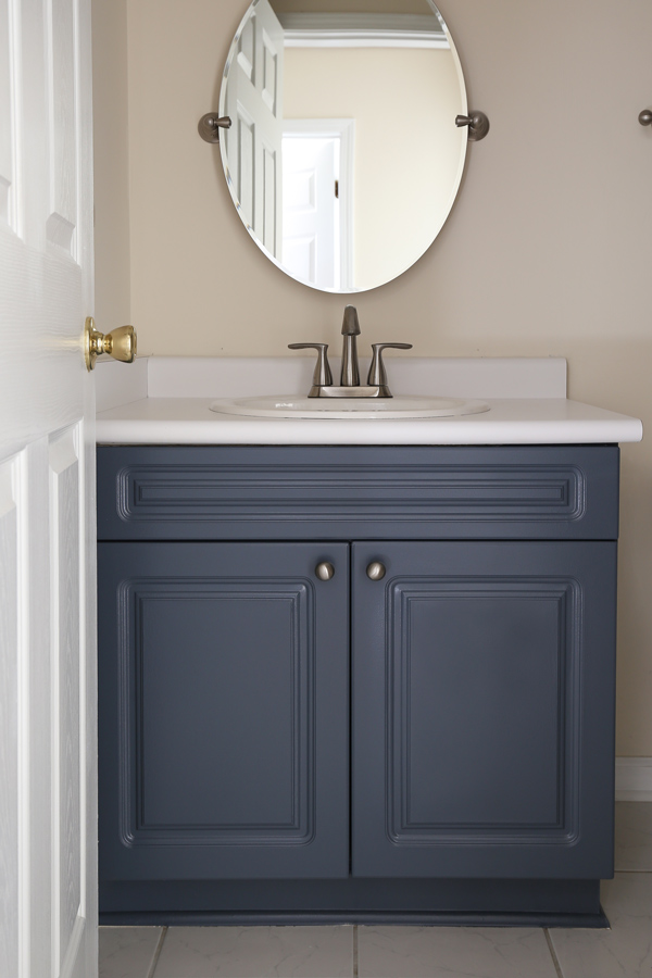 A painted bathroom vanity in blue grey paint