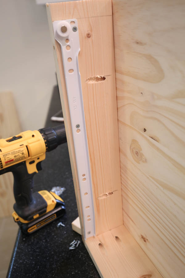 Attaching drawer slide on interior of makeup vanity