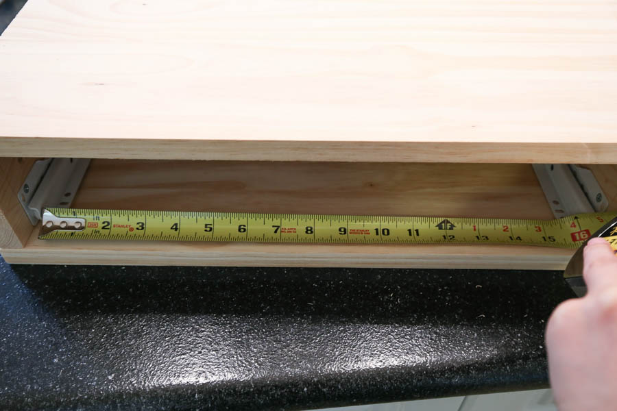 Measure distance between drawer slides with tape measure