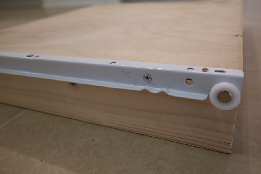 Side view of the DIY drawer box and drawer slide which is attached with screws