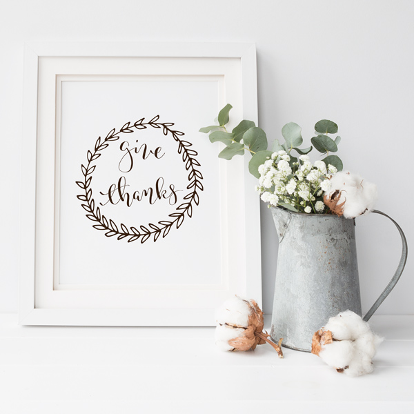 Free Thanksgiving Printable in a picture frame with a pitcher of cotton and greenery