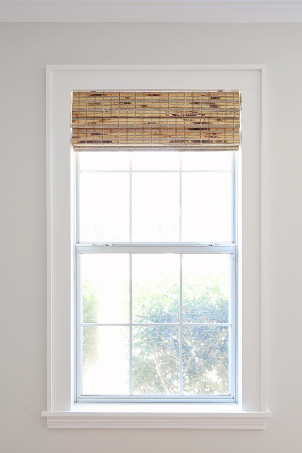 Painted DIY window trim with bamboo blinds