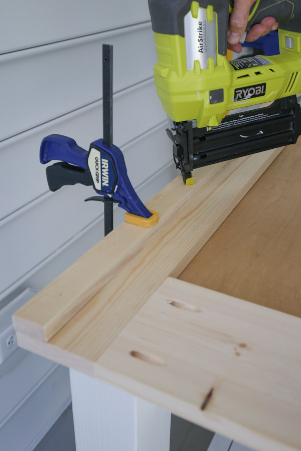 building the barn door frame with 1x2s installed on 1x6s with brad nailer