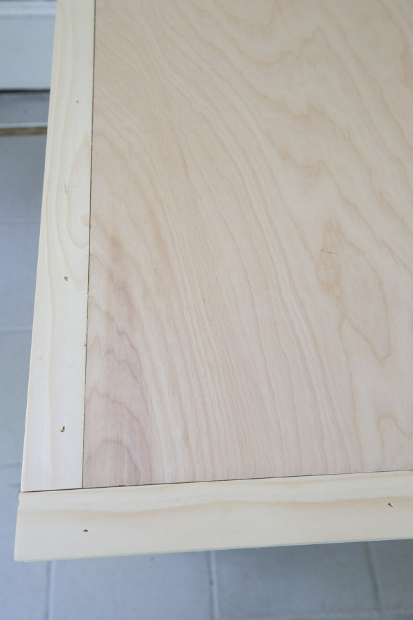 """using 1/4"""" plywood to cover the back of the barn door"""