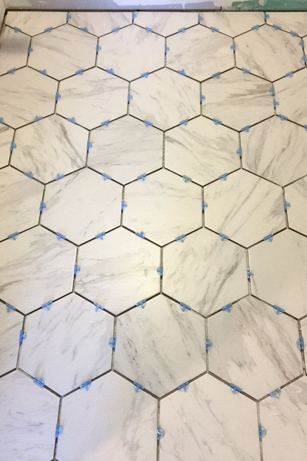 installing marble look porcelain hexagon tile