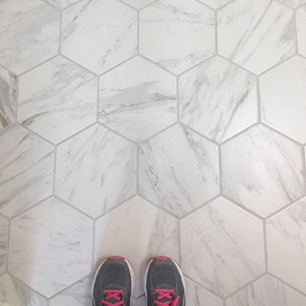 Hexagon Porcelain tile that looks like marble on a bathroom floor