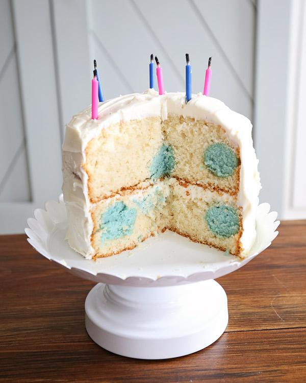 gender reveal polka dot cake with blue polka dots