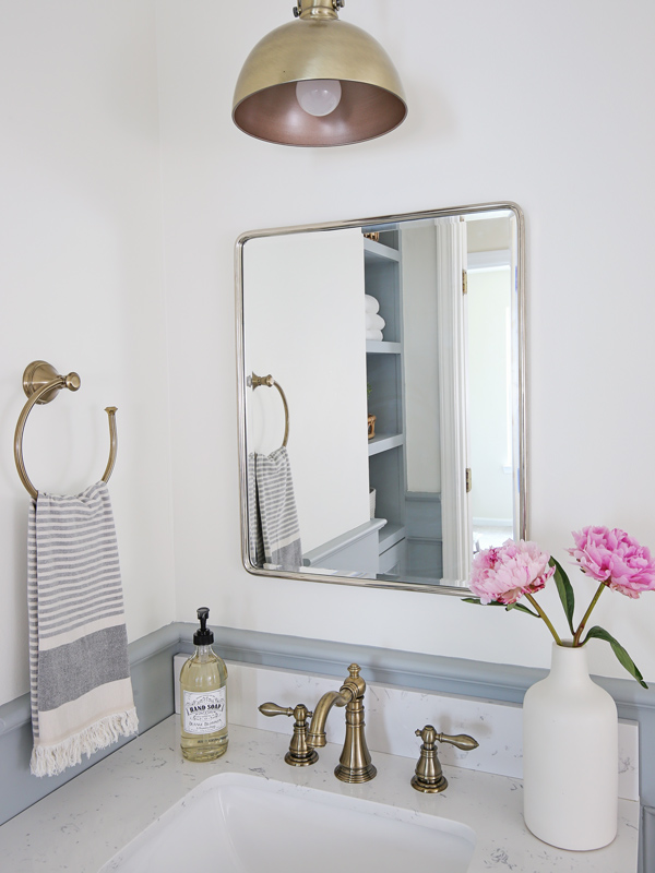 mixed metals in bathroom with mirror and sink facuet