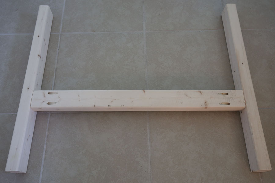 two short boards attached to long board to start forming outdoor couch side frames