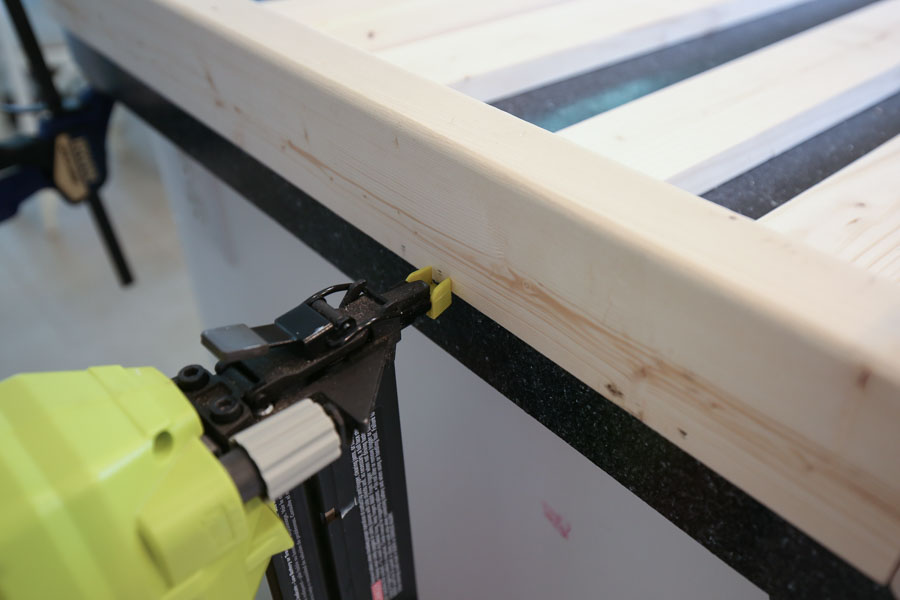 Add side slat boards to side frames with brad nailer and brad nails