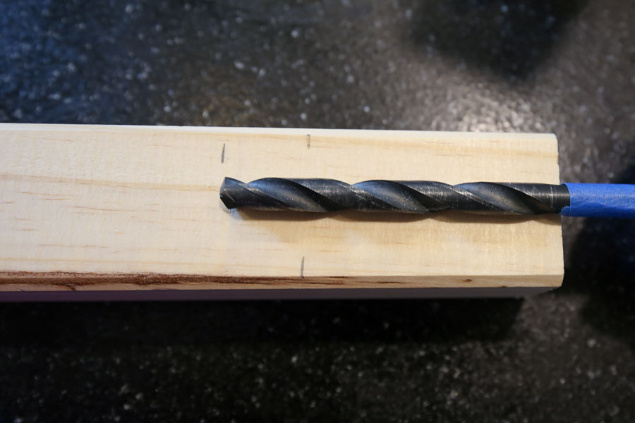setting up drill bit for drilling holes in dresser legs