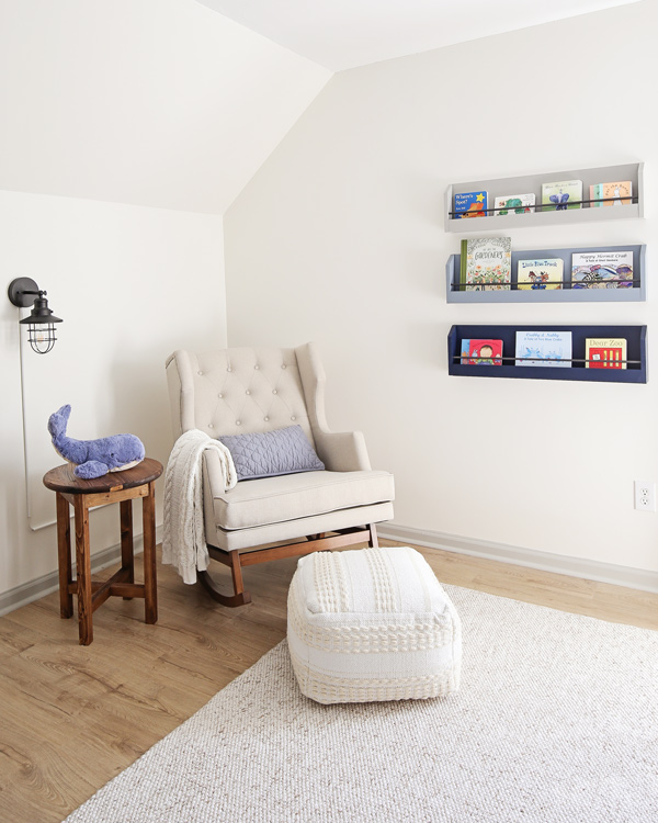 nursery reading nook with rocker and bookshelves on wall