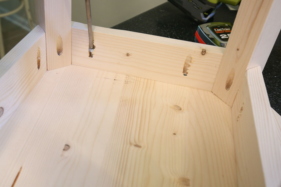 Attach DIY end table aprons and base to table top board with Kreg screws and pocket holes