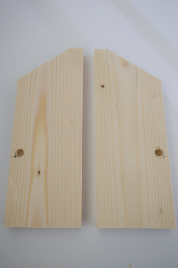 DIY bookshelf wall side pieces with hole drilled for dowel rod and ready for assembly