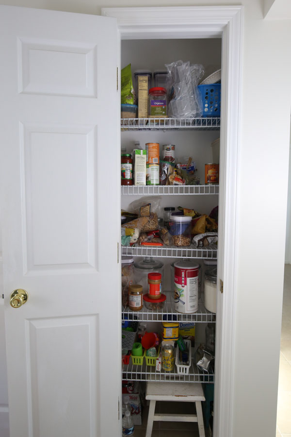 before pantry photo with wire shelving and unorganized mess in the pantry