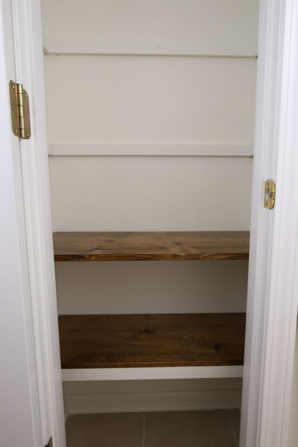 place diy wood pantry shelves on top of shelf supports
