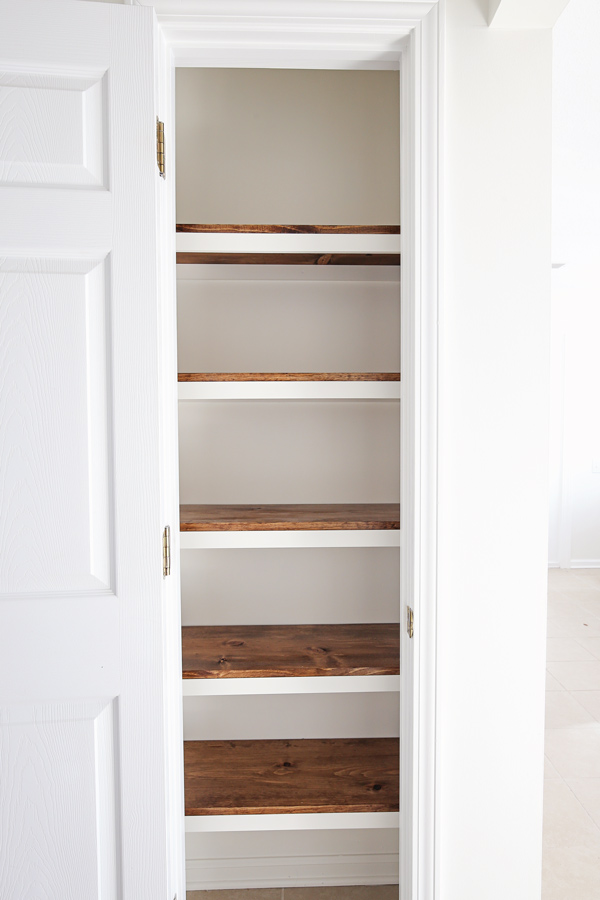 DIY Pantry Shelves with closet door open
