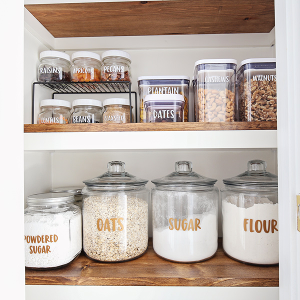 how to make vinyl labels with cricut with pantry labels on jars on pantry shelf
