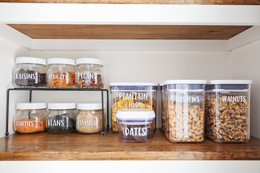 how to make labels with cricut with pantry labels on jars on pantry shelf