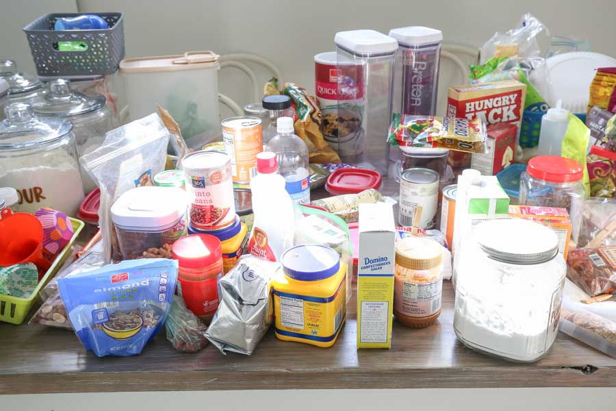 all pantry items removed from pantry and placed on kitchen table