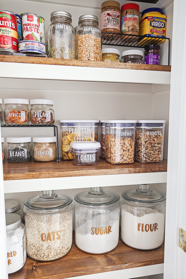 how to organize a small pantry with pantry containers and bins on pantry shelf