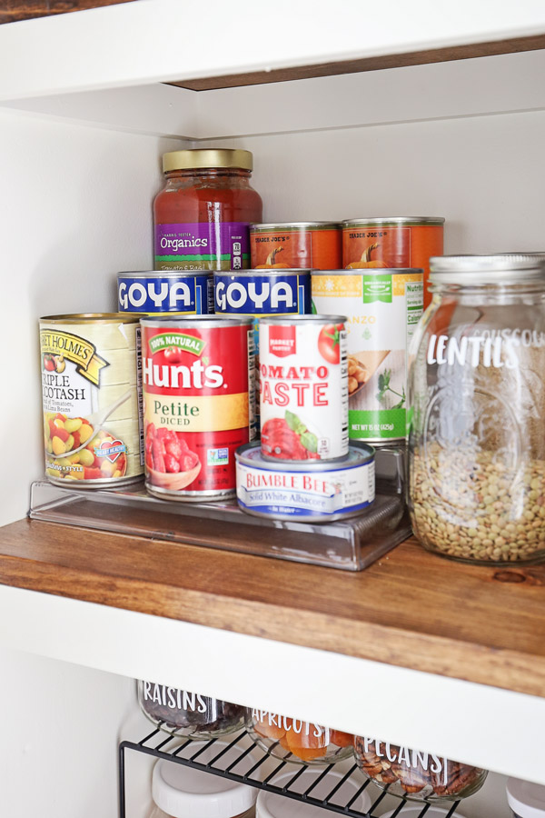 tiered pantry shelf with canned goods