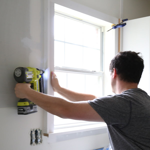 adding custom window trim to window with brad nailer