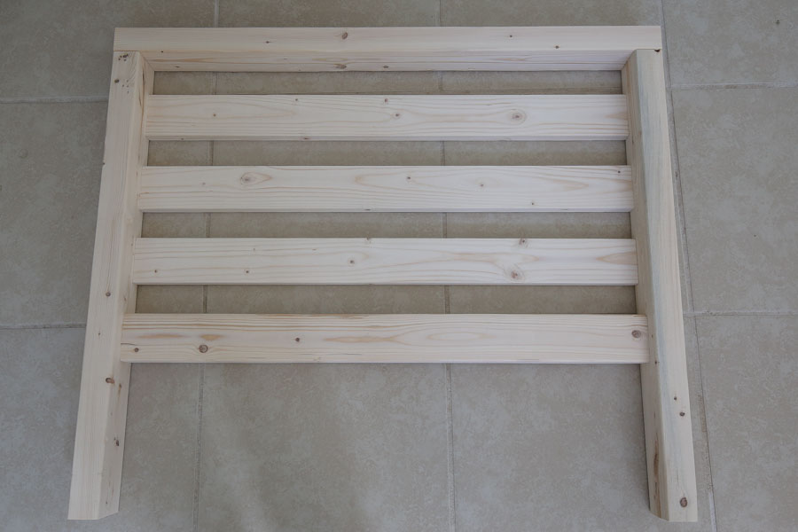 Add side slat boards to DIY outdoor chair side frames