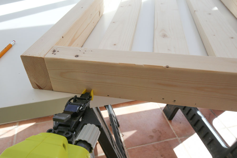 Add side slat boards to chair side frames with brad nailer